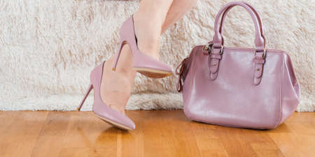 Pair of beige womens high-heeled shoes Feet bag powder color