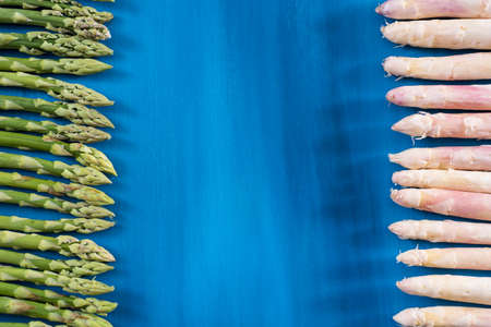 Fresh green asparagus shoots pattern, on a blue wooden background Stock Photo