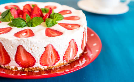 Strawberry cake with sour cream on a blue background Stock Photo