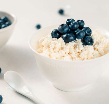 cottage cheese and blueberry in a bowl on a table