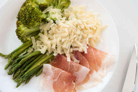 Parma ham, asparagus and arugula broccoli, healthy eating, diet Stock Photo