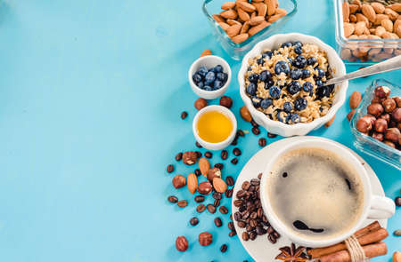 Perfect breakfast. Oatmeal with blueberries. Healthy eating for the whole family. wood background.