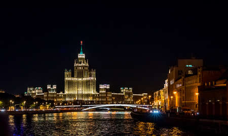 Stalin Skyscraper on Kotelnicheskaya Embankment of the Moscow River. Night Panorama view of Moscow city, Russia
