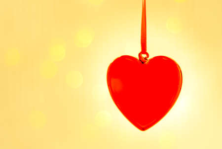 Valentines day greeting card, valentines day background, red glass heart, against a background of lights