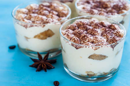 luxurious dessert tiramisu in glasses, the concept of sweet life
