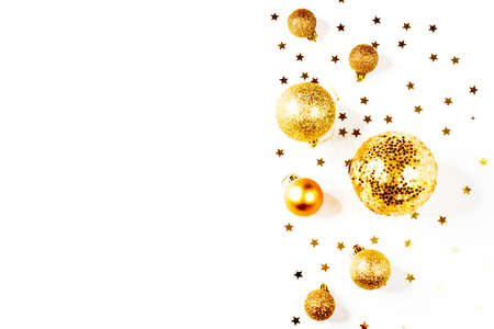 Christmas composition. a pattern of golden christmas balls and stars from above. Flat lay, top view