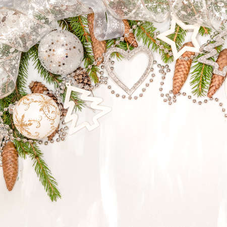 golden and silver christmas background, with branches of a New Year tree, cones, Christmas toys