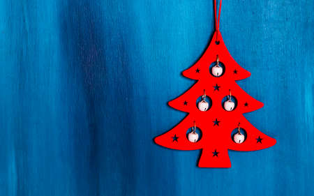 Christmas decoration hanging over wooden blue background