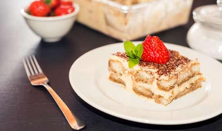 Homemade Tiramisu cake decorated with strawberries Italian cuisine