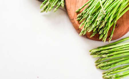 Asparagus, a bunch of fresh asparagus on a wooden cutting board