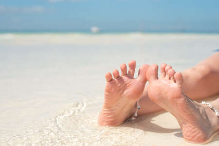 feet, sole of feet against the sea Pedicure and foot Spa .Care for the heels and soles of the feet