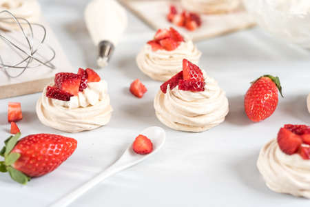 Strawberry pavlova cake, meringue decoration on a culinary table Stock Photo