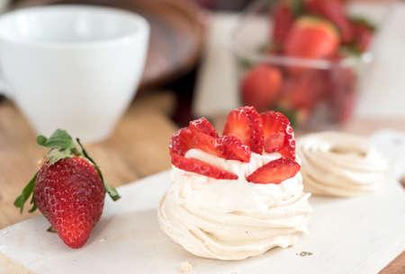 small meringue Pavlova dessert with strawberry