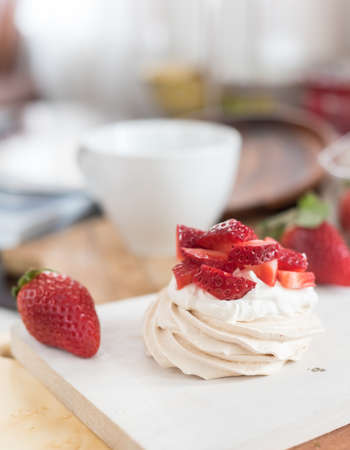 small meringue Pavlova dessert with strawberry