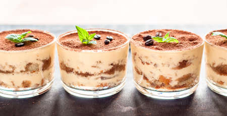 Traditional Italian dessert tiramisu in a glass.