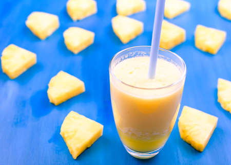 Fresh pineapple juice in the glass,selective focus Stock Photo