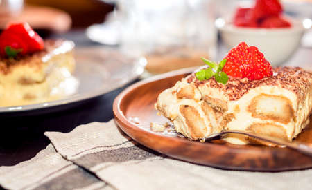 Tiramisu - Classical Dessert with Strawberry and Mint Stock Photo