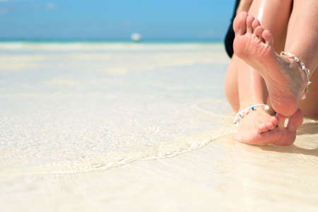 womens feet, on the beach, concept, tourism, pedicure, grooming