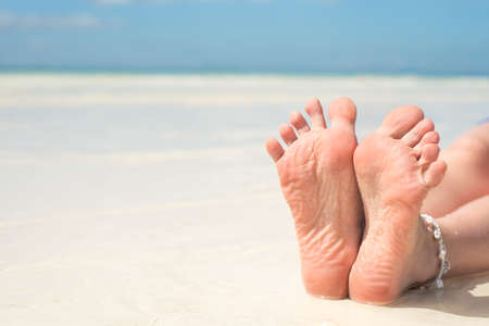 women's feet, on the beach, concept, pedicure grooming Stock Photo - 103036209