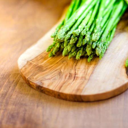 Asparagus, a bunch of fresh asparagus on wooden board