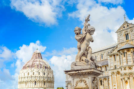 Marble statue in front of the Leaning Tower of Pisa in Piazza dei Miracoli Square of Miracles , Tuscany, Italy Stock Photo