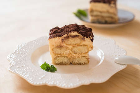 Italian tiramisu dessert on a porcelain plate Stockfoto