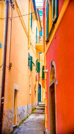 Colorful buildings in Monterosso in Cinque Terre, Italy on sunny day.