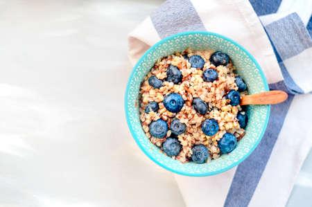 High protein healthy breakfast, buckwheat porridge with blueberries, flax seeds