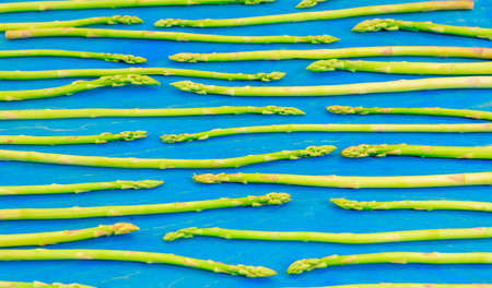 Fresh green asparagus shoots pattern, top view. Food background asparagus flat lay