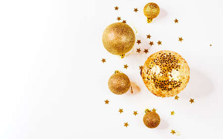 Christmas balls. Christmas composition. a pattern of golden christmas balls and stars from above. Flat lay, top view 写真素材