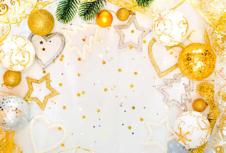 abstract christmas decor in gold and white caves with christmas toys and decor