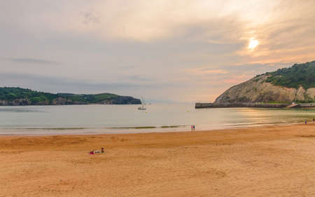 Playa De Gorliz at sunset, Spain, Bilbao Фото со стока