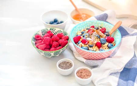 High protein healthy breakfast, buckwheat porridge with blueberries, raspberries, flax seeds and honey Closeup view, selective focus Stock Photo - 109520982