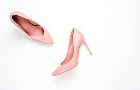 Pale pink female shoes on white background. Flat lay, top view trendy fashion feminine background. Beauty blog concept. Imagens