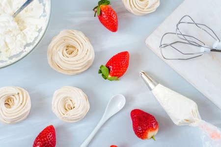 Homemade small strawberry pavlova meringue cakes pattern with cream