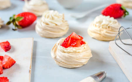 Strawberry Pavlova dessert with fresh mint Stok Fotoğraf