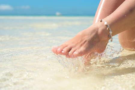 Sensual womans legs in clean water splashes.