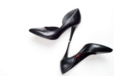 Fashion blog look. Black women high heel shoes on white background. Flat lay, top view trendy beauty female background.