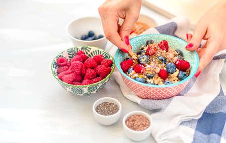 High protein healthy breakfast, buckwheat porridge with blueberries, raspberries, flax seeds and honey Closeup view Stock Photo - 111666092