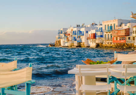 Restaurant near the sea on the island of Mykonos in Greece at sunset