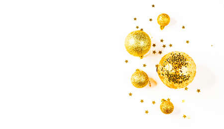 Christmas balls. Christmas composition. a pattern of golden christmas balls and stars from above. Flat lay, top view Stock fotó