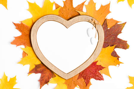Autumn composition, maple leaves, heart shaped frame, top view, flat lay Imagens