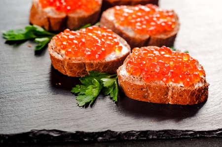 Red caviar on slate