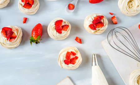Homemade small strawberry pavlova meringue cakes pattern with cream