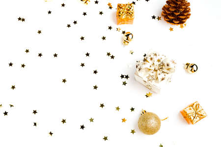 Flat Lay with Christmas golden deco baubles on white. Stock Photo