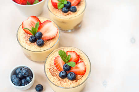 Homemade, exquisite dessert tiramisu in glasses decorated 스톡 콘텐츠