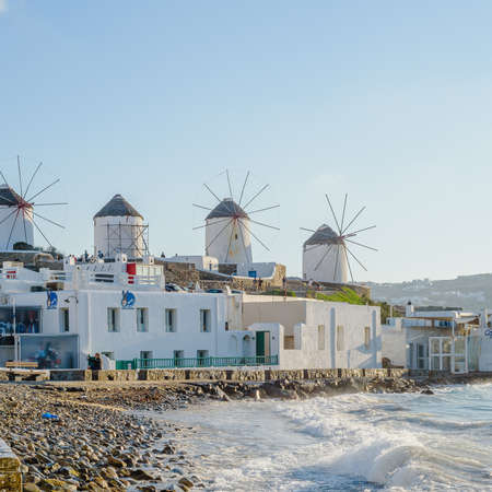 A number of mills on the hill near the sea on the island of Mykonos in Greece - the main attraction of the island