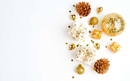Flat Lay with Christmas golden deco baubles on white. Copy Space. Horizontal.