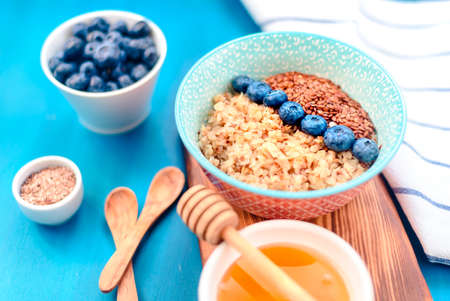 Buckwheat porridge in a bowl with flax seeds and blueberries. oncept healthy food, detox, diet Stock Photo - 118403714