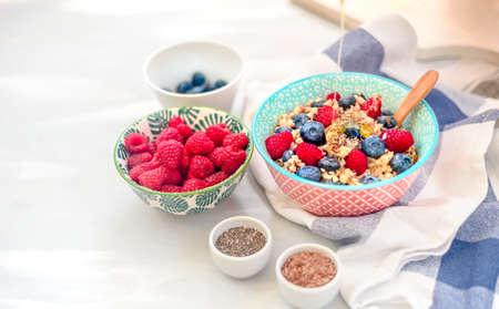 High protein healthy breakfast, buckwheat porridge with blueberries, raspberries, flax seeds and honey Closeup view Stock Photo - 118403717